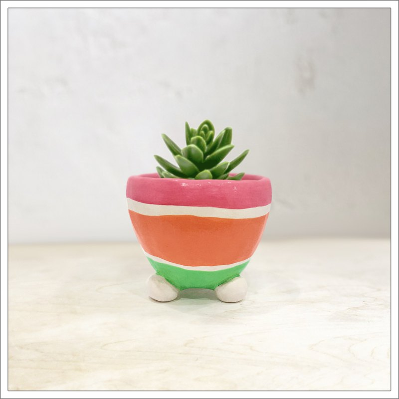 Hand pinched and painted ceramic pot in pink, orange and green straps