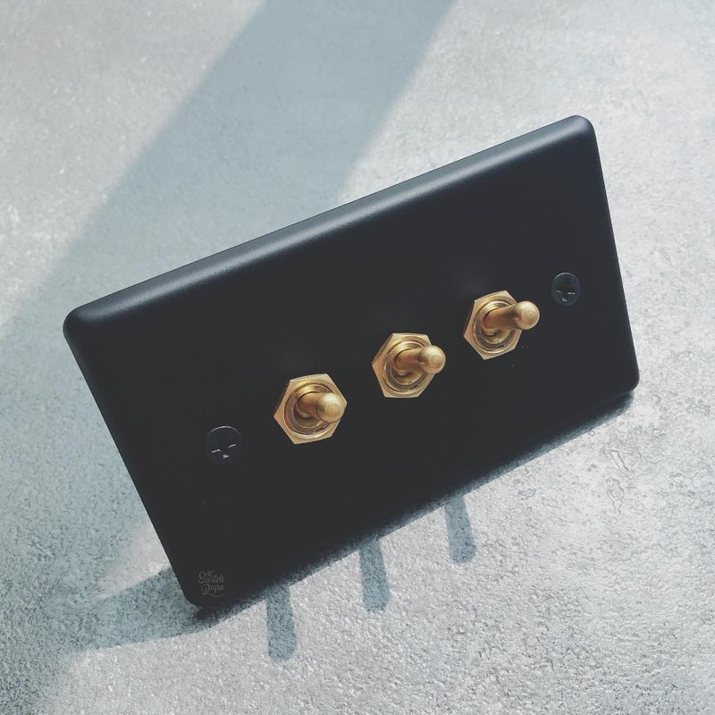 Matte fog black panel vintage brass switch 3 open