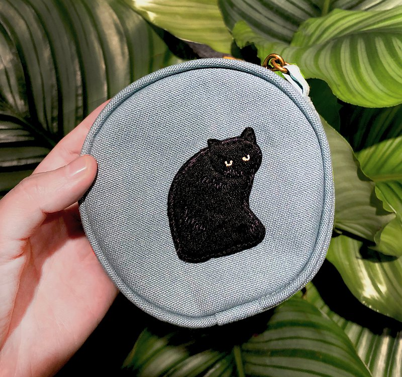 Hand holding black cat small coin purse