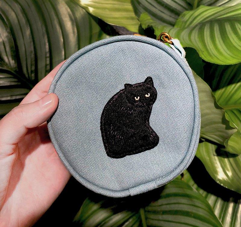 手拿黑貓小零錢包
