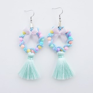 Light mint circular earrings with tassel and pink bow