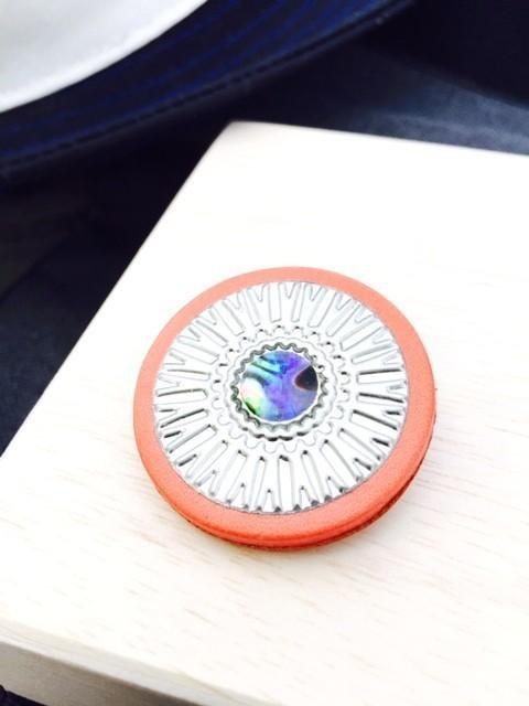 Leather brooch is two-tone in color(arch)