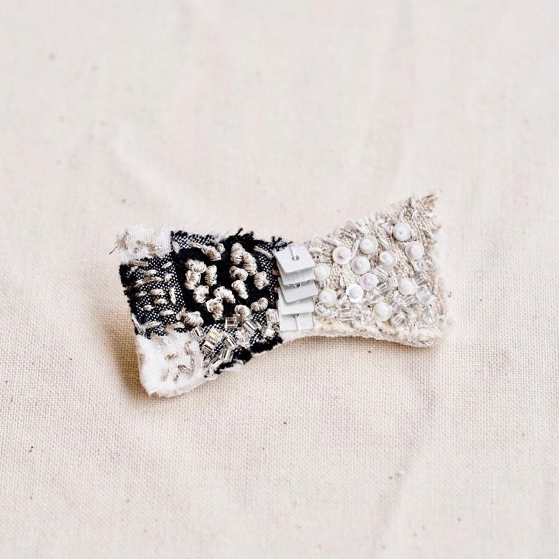 White brooch k