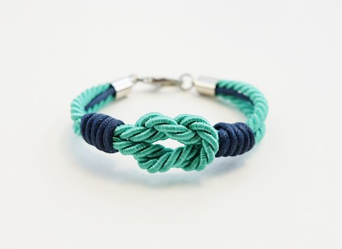 Mint tie the knot bracelet with navy blue waxed cotton cord