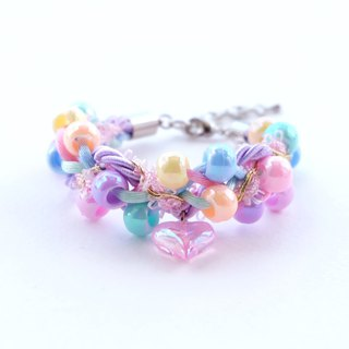 Colorful pastel braided bracelet with pink heart charms