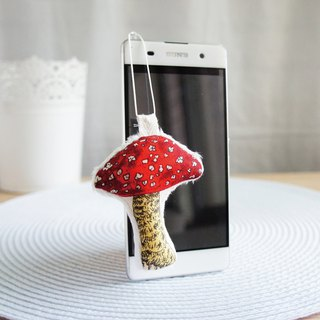 Lovely red mushroom earphone dust plug (middle) on the back is a screen wiper, mobile phone strap