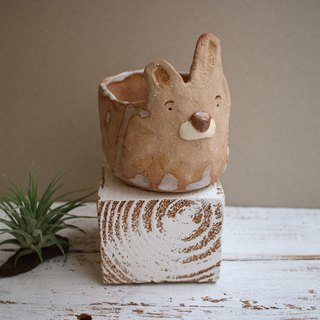 The third floor hand made pottery striped rabbit potted flower