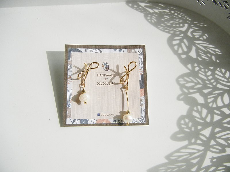 *coucoubird*Asymmetric bow earrings
