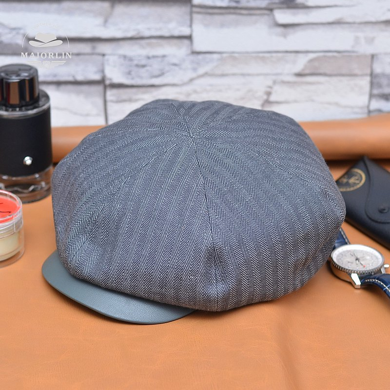The combination of classic newsboy hat leather and tooling fabrics