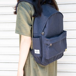Small day dark gray blue warm sun wrinkled backpack