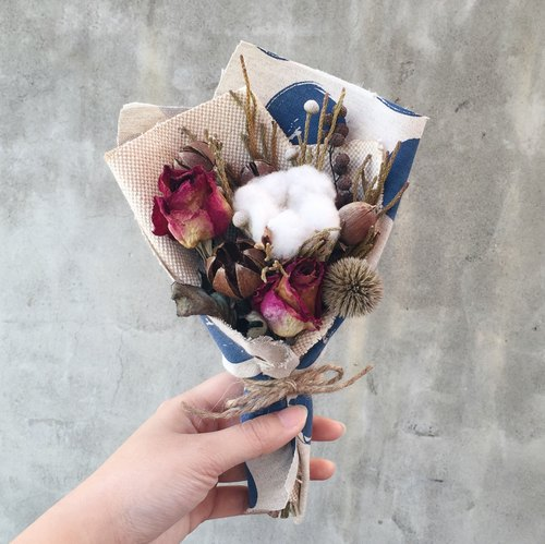 Drying bouquet of cotton roses