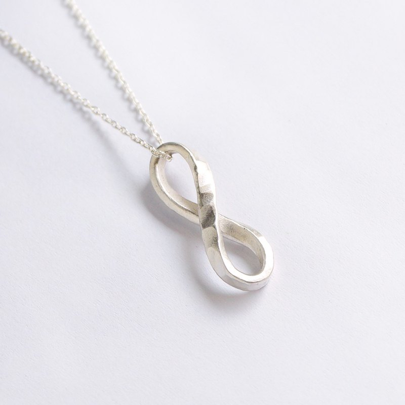 Multiplied by infinite forging knock twisted sterling silver necklace