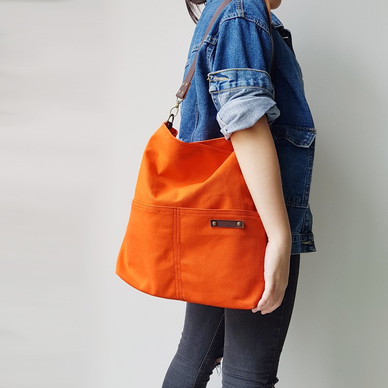 COTTON CANVAS IN ORANGE COUPLE SLING BAG / TOTE WITH GENUINE LEATHER STRAP