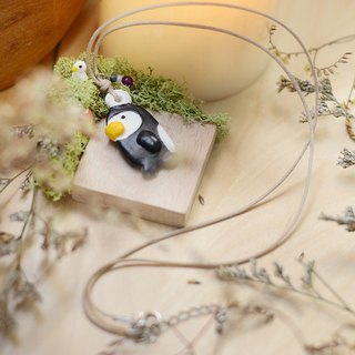a little penguin handmade necklace from Niyome clay.