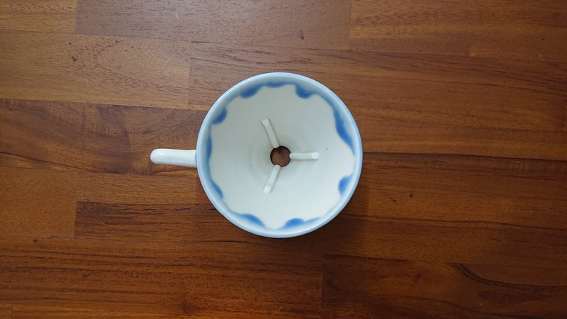 Drops of espresso coffee filter cup - blue