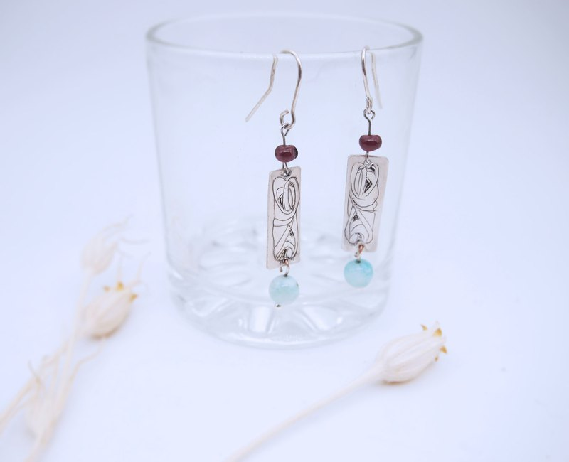 Hand carved sterling silver la Lima earrings