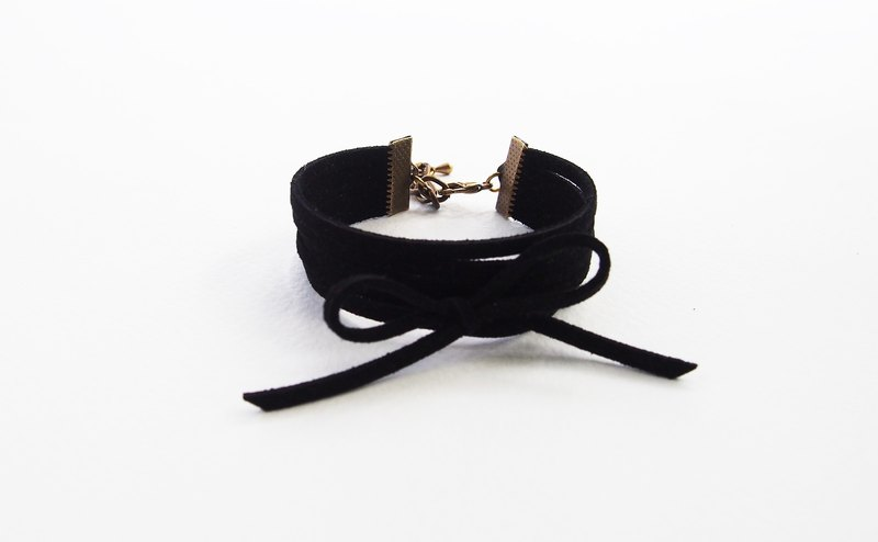 Black suede cord layering with bow bracelet