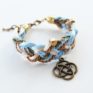 Blue Cream Brown braided bracelet with brass materials