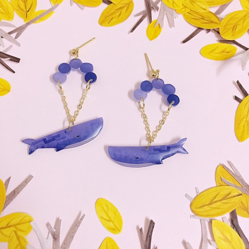 A pair of whale Earrings