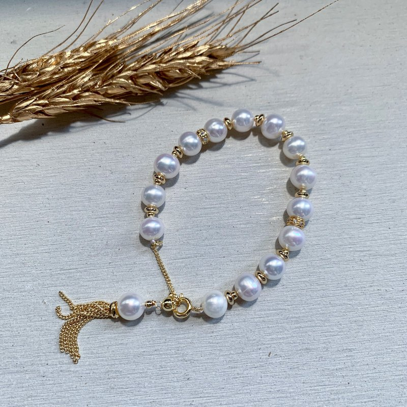 Natural freshwater pearl small taro pearl tassel bracelet adjustable