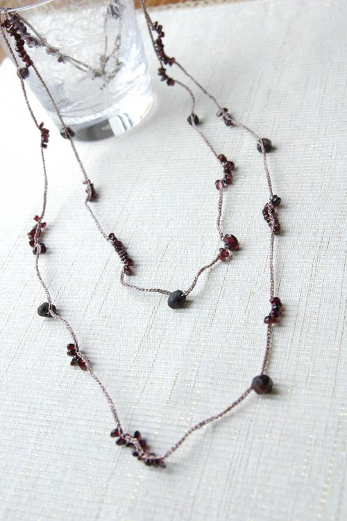 Crochet necklace of garnet