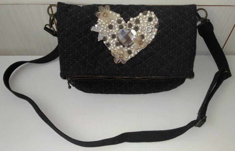 Heart-to-heart cross-body bag