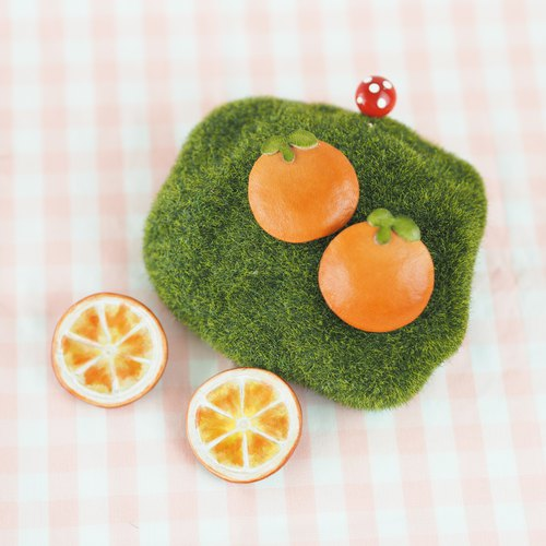 Small orange leather pin peel fruit pulp