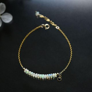 A stone fairy stone water opal bracelet that fulfills a wish October birthstone