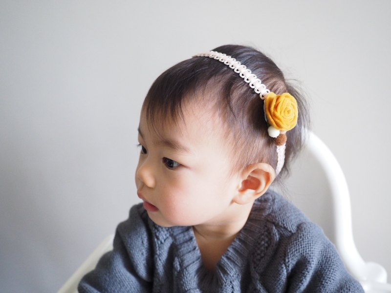 Handmade baby headband with yellow flower