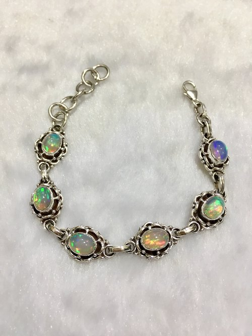 Opal Bracelet in Braided Pingtail Designed Handmade in Nepal 92.5% silver