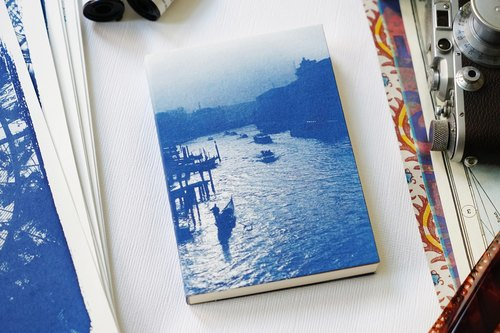 Hand sun and blue notebook - Romantic River