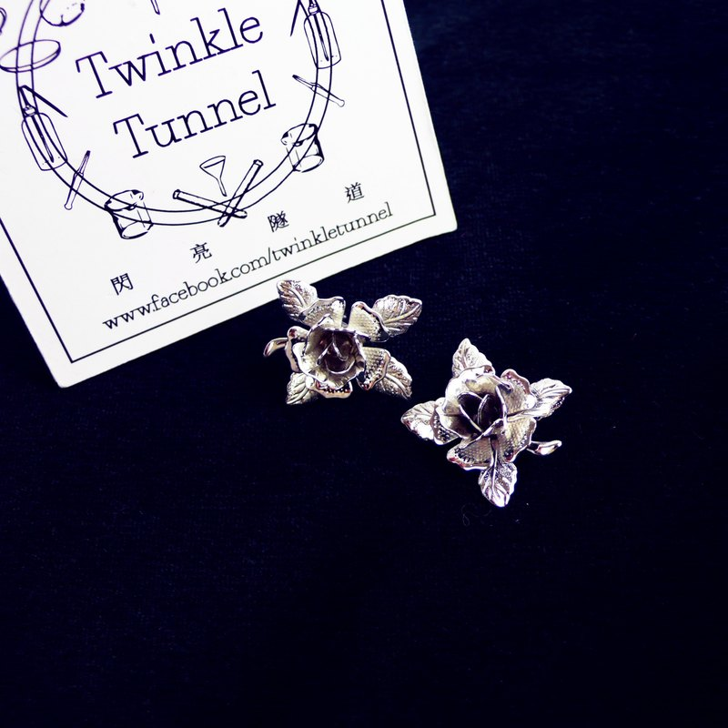 Silver rose earrings ear