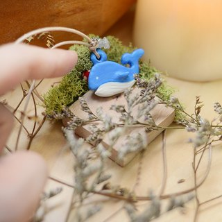 a little blue whale handmade necklace from Niyome clay.