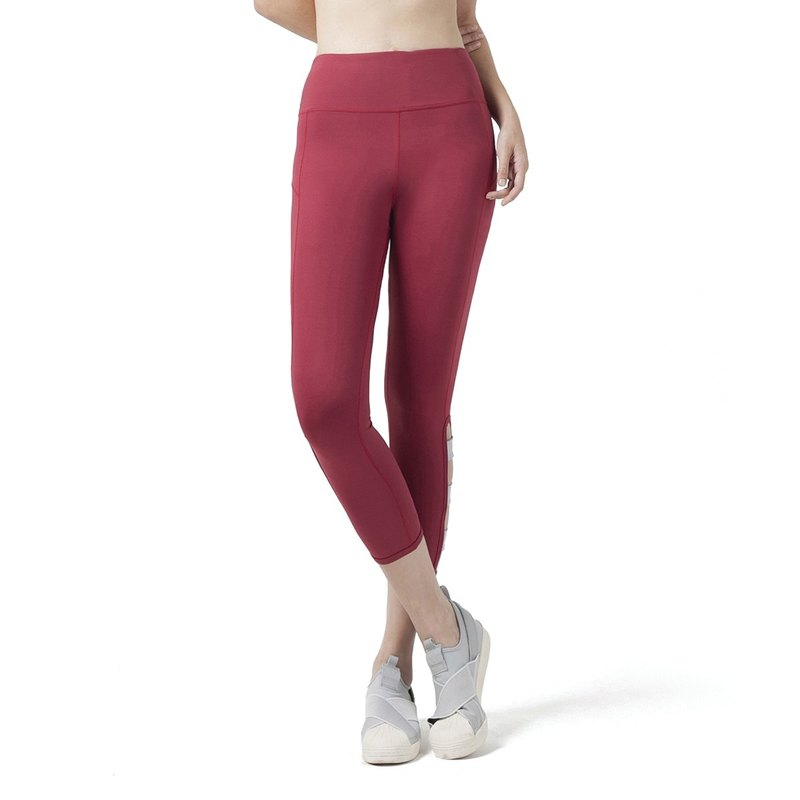 Fold crop leggings in brick red / grey.