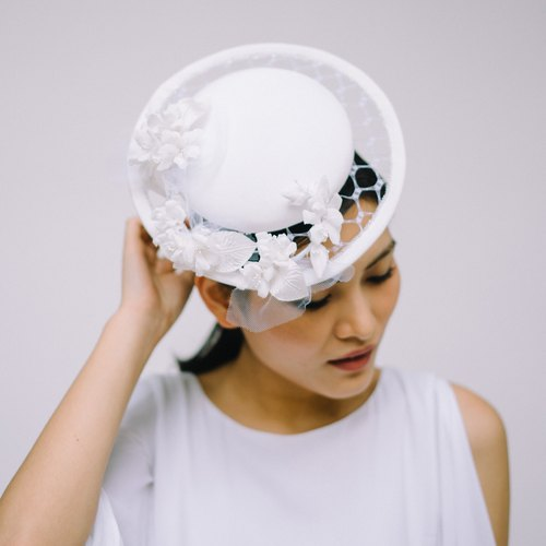 Millinery - White silk button hat with netting brim