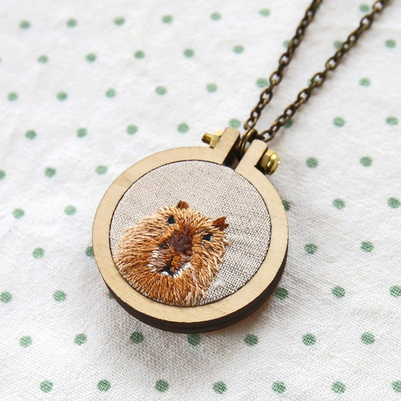 Hand-embroidered capybara frame necklace