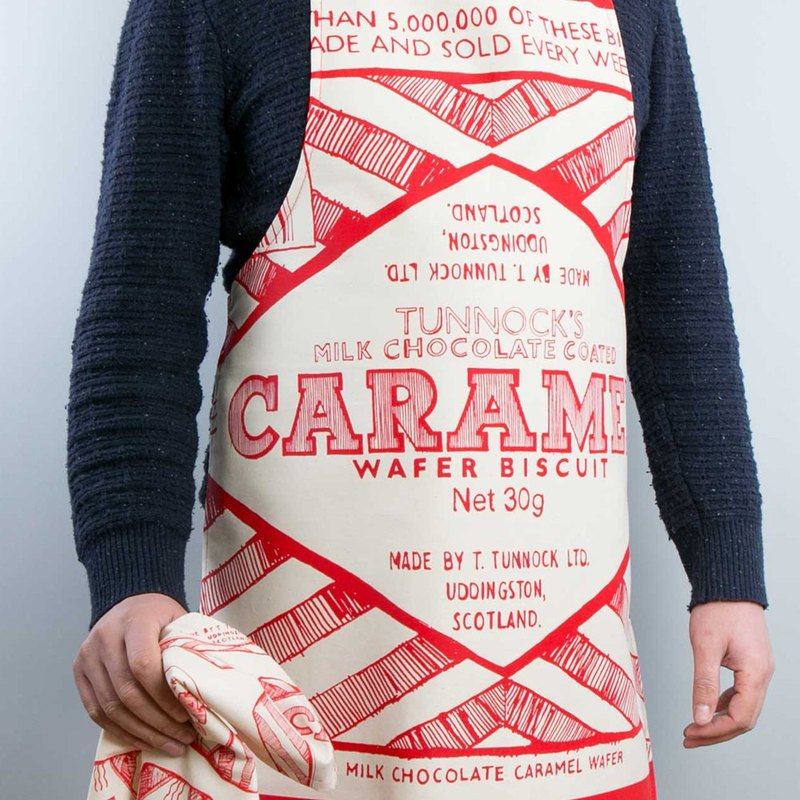 British Gillian Kyle and Tunnock jointly design pop style hand-painted caramel biscuit text apron