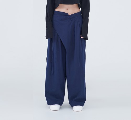 TRAN - piece pleated twisted trousers