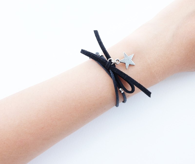 Black cord bracelet with suede bow and star charm
