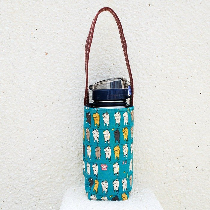 Tan cat _ blue kettle bag / order