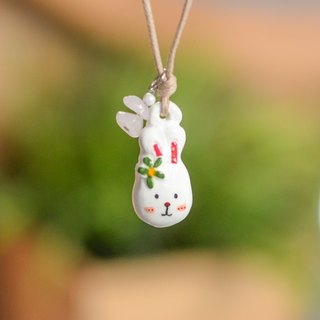 A little white cut rabbit handmade necklace from Niyome Clay.