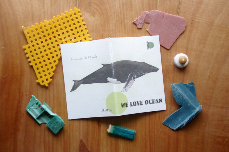 Hand-painted whales blank notebook