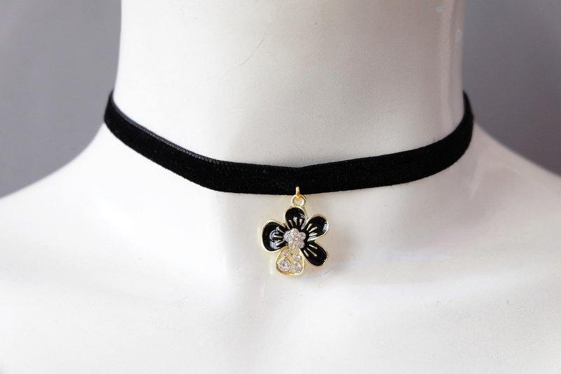 Black velvet choker with diamond black flower charm