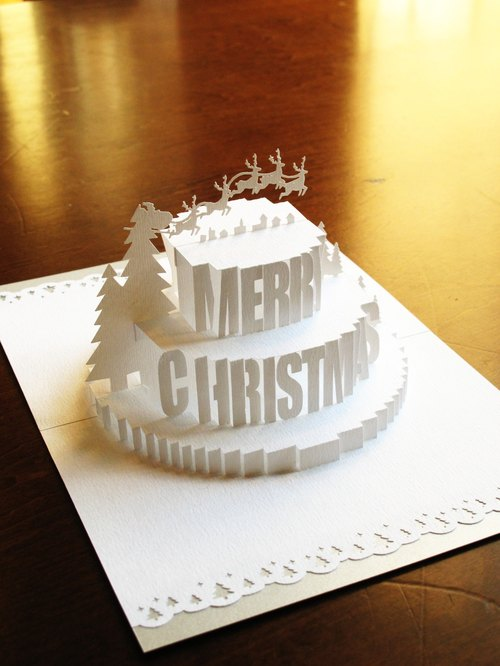 Three-dimensional paper carved Christmas card - Christmas cake - snow white