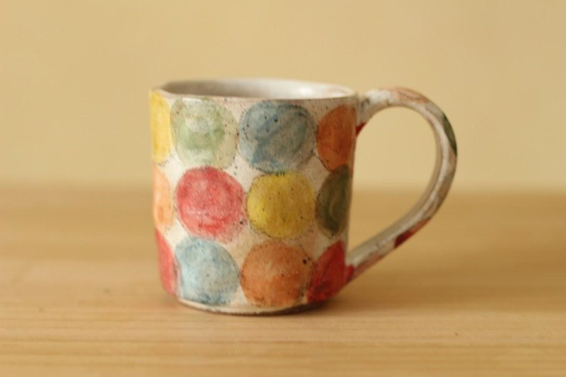 Cup of colorful dot dusting.