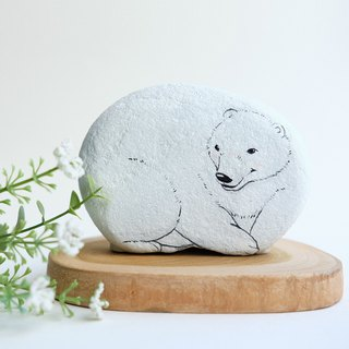 Polar bear stone painting.