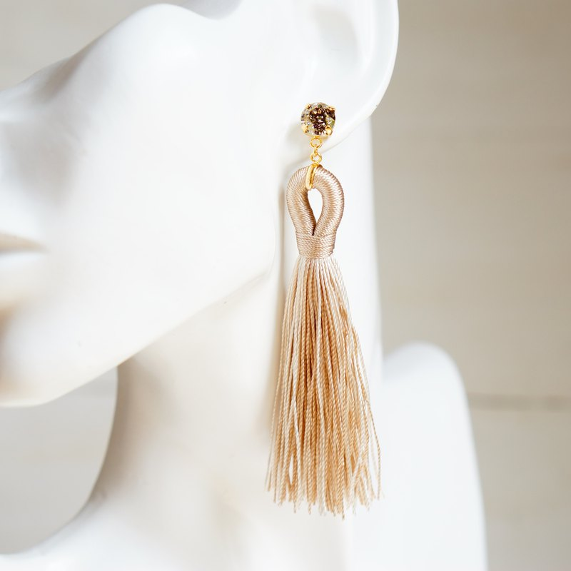 Swarovski and tassel earrings with gold