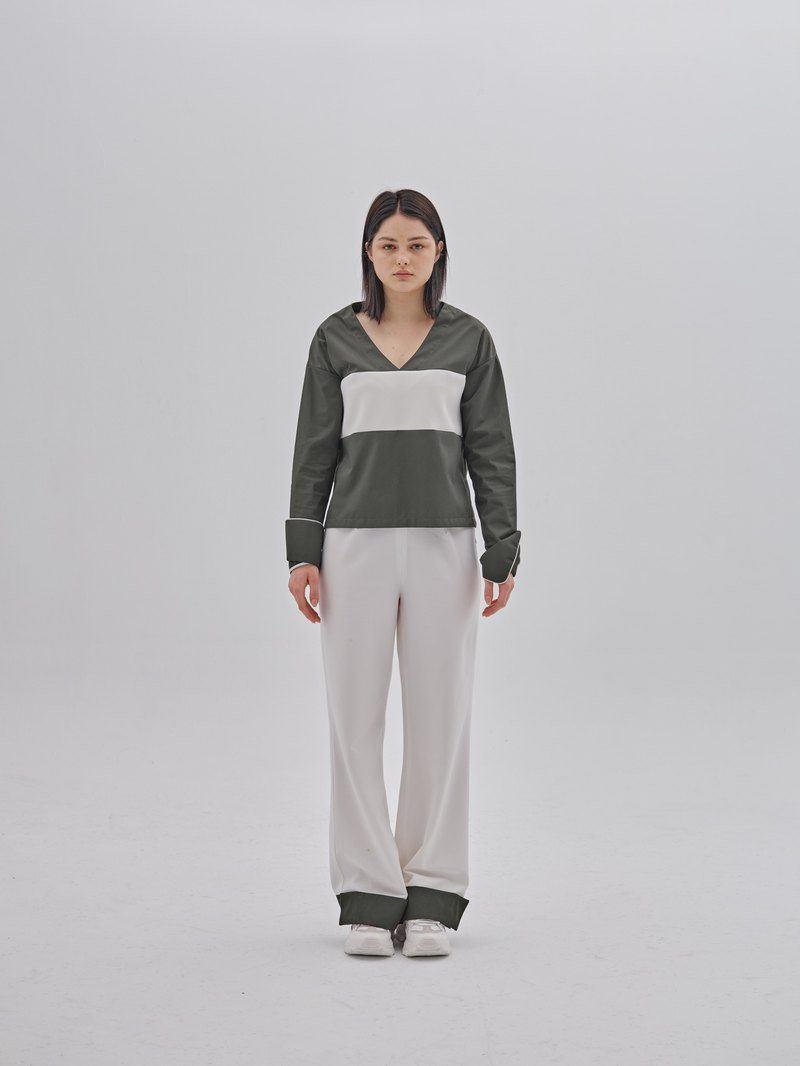 Dark green and white stitching flared pants