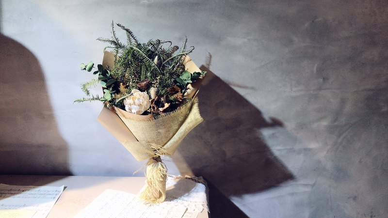 The small world of Jurassic. Original dry flower bouquet. Small green forest.
