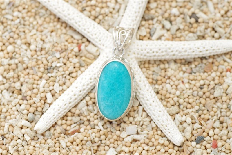 Beautiful light blue crystal. Silver pendant top of Amazoniaite